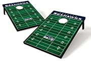 """Seattle Seahawks - official NFL merchandise! This football field style corn hole board set celebrates your Hawks, and is sized right for tailgate parties and grilling picnics. The two included boards, the """"endzones"""", and all eight durable, regulation..."""