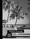 Travel Journal: Large black and white camper van at beach travel journal...