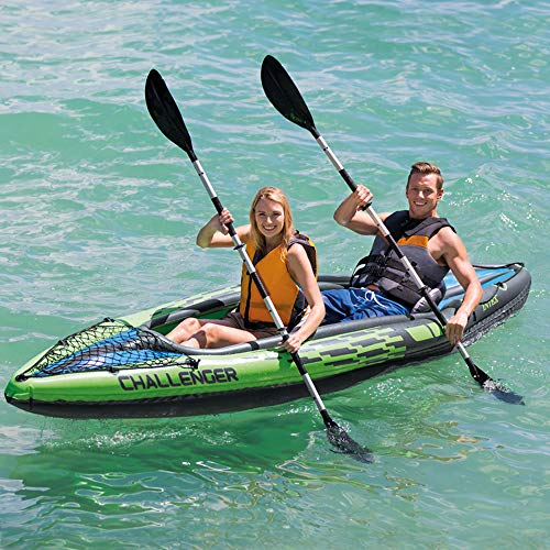 a guy with a girl rowing oars on an inflatable gifts