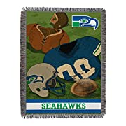 """Features vintage football gear, jersey, helmet and NFL team logo Detailed, woven throw blanket; decorative fringes around all edges; made in America Measures 48""""W x 60""""L Machine wash cold separately using delicate cycle and mild detergent. Do not ble..."""