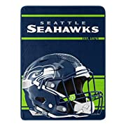 """Features NFL team name and established year above the team helmet on a solid color background Soft and warm micro raschel fabric; decorative binding around all edges Measures 46""""W x 60""""L Machine wash cold separately using delicate cycle and mild dete..."""