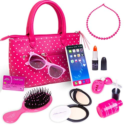 51ktkBKDsTL KEEP YOUR LITTLE GIRLS BUSY FOR HOURS: Toss away all those same old toys and get the ultimate pretend play makeup purse set for your girl. Make sure your kids enjoy interactive playing and keep them busy for hours! This makeup kit can enhance her creativity and let her doll herself up without asking for your own makeup products. MY TOY PURSE PLAYSET INCLUDES: A brush, keys with alarm FOB, necklace, pretend phone, purple nail polish, a compact with shatterproof mirror and a puff, a red lipstick, and a credit card. Teach your girls the specific purpose of each product and have fun with colors. All of the cosmetic products come in an adorable pink polka dot purse! PROMOTE INTERACTION & IMAGINATIVE PLAY: This educational makeup playset will engage your little ones in imaginative and learning pretend play. Let your child actively experiment with various social and emotional roles of life. Promote cooperative play, teach them how to take turns, share responsibility, and achieve creative problem-solving.