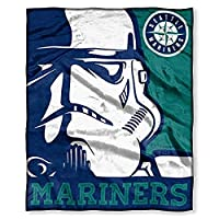 "Features a Stormtrooper next to an MLB team logo; team name across bottom Super soft, silk touch fabric Measures 50""W x 60""L Machine wash cold separately using delicate cycle and mild detergent. Do not bleach. Machine dry separately on gentle cycle. ..."