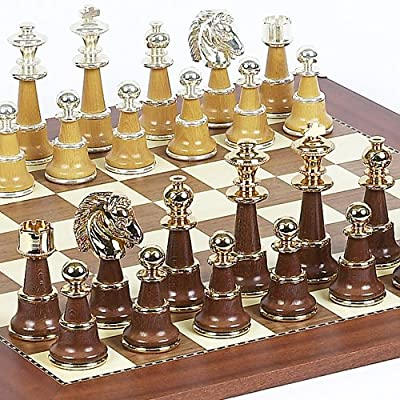 """Solid Brass Chessmen Plated With 24K Gold/Silver, With Maple/Walnut In Between From Italy. VERY Heavy In Weight Naturally. Maple/Walnut Chess Board With a Beautiful Mosaic Boarder With Brass Corners From Spain. King Height: 5"""""""