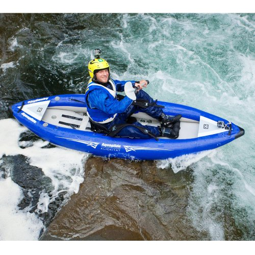 kayak rafting on the rapids of the river