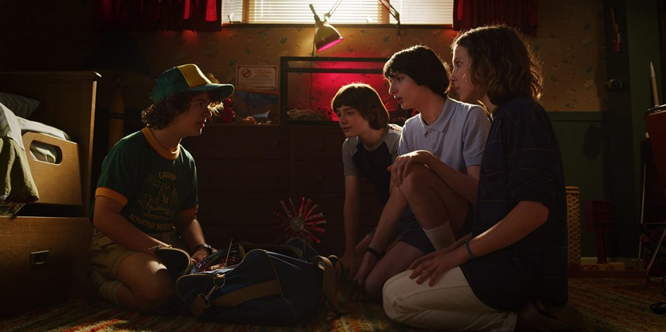 Millie Bobby Brown, Finn Wolfhard, Noah Schnapp, and Gaten Matarazzo in Stranger Things (2016)