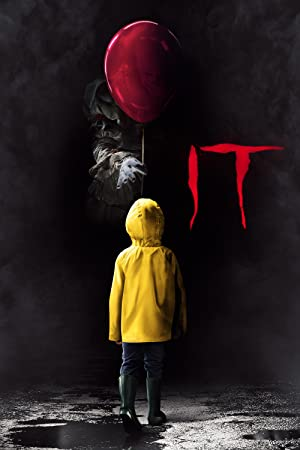 Poster do filme - It a Coisa - A mão do palhaço entregando um balão para uma criança de capa amarela
