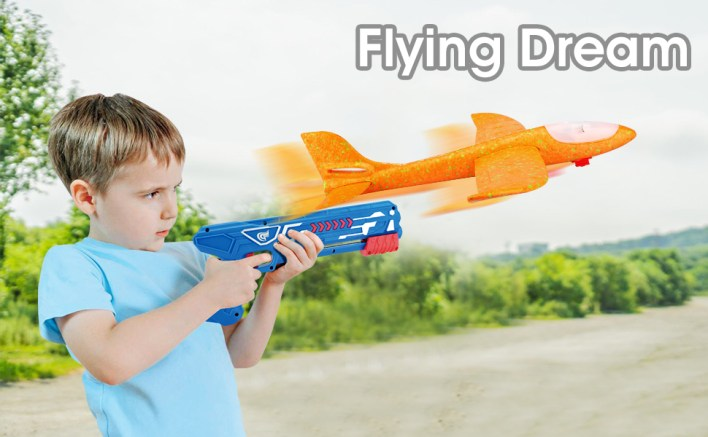 A cute little boy fly the airplane toy by launcher, best outdoor toys for toddlers age 2-4
