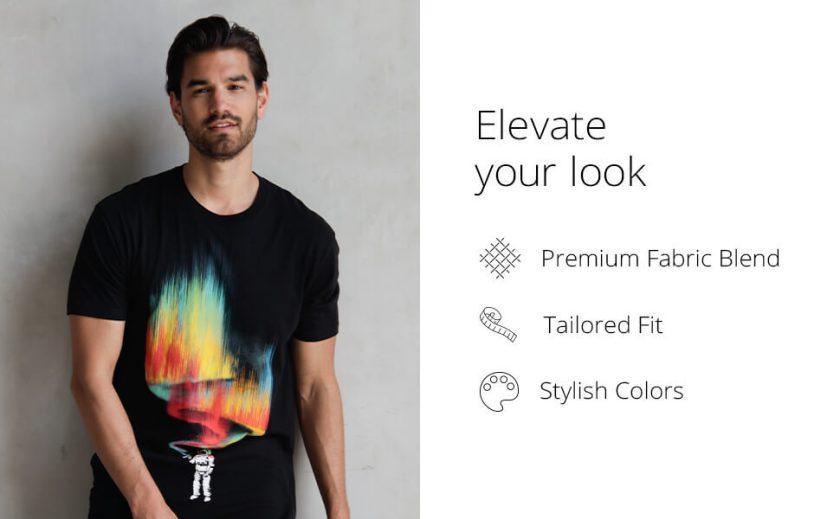 into the am model wearing black diamond graphic tee astronaut t-shirt