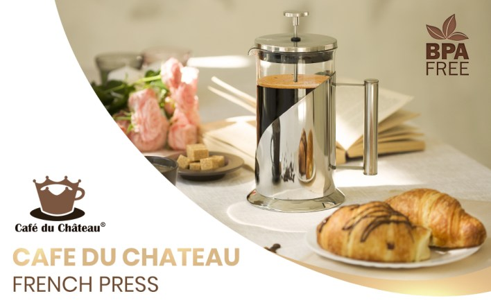 Cafe Du Chateau French Press on table with croissants and book