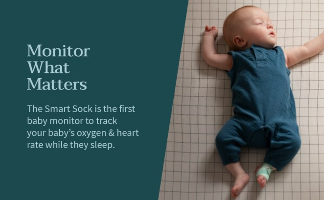 Baby sleeping with smart sock monitoring heart rate and oxygen