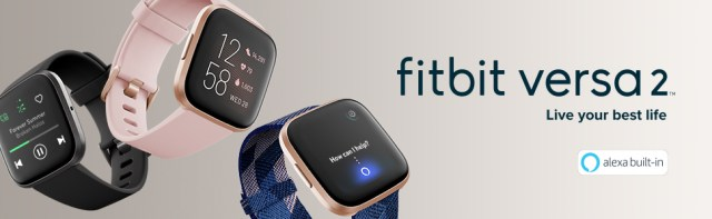 Three fitbit Versa 2 watches in various color bands