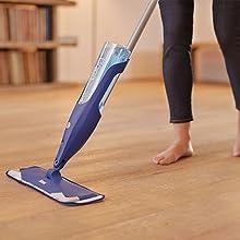 Woman moping floor using the floor cleaner