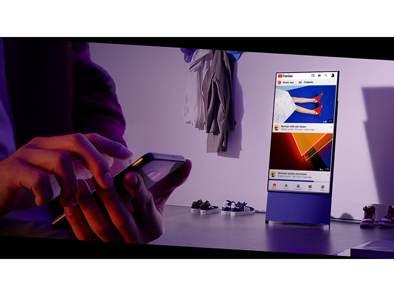 person using a phone showing website on device in background