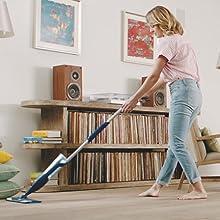 woman mopping wood floor
