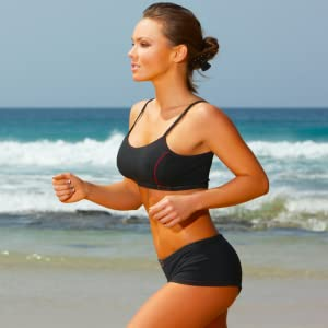 Lady with glowing complexion and healthy hair running on Bondi Beach
