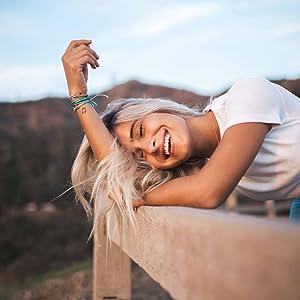 girl laughing wearing bracelets