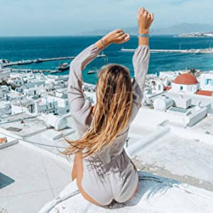girl on roof arms up wearing bracelets