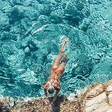 girl swimming in orange bikini