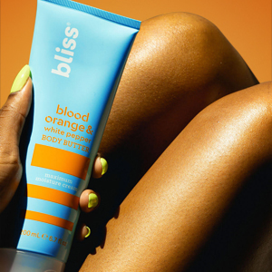 body butter against tanned legs