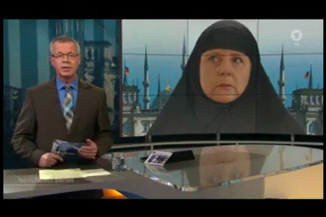 Il Reichstag trasformata in una moschea e Angela Merkel czadorze - così TV tedesca avverte di islamizzazione in Germania