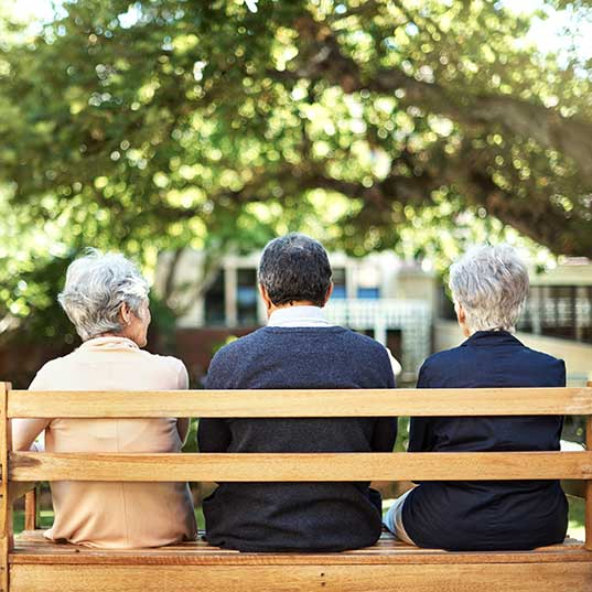 seniors visiting on a bench