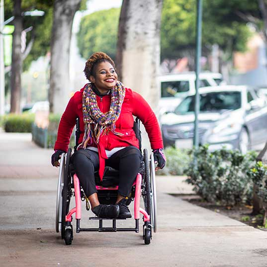 young woman in a wheelchair downtown
