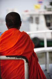 Monk on a boat