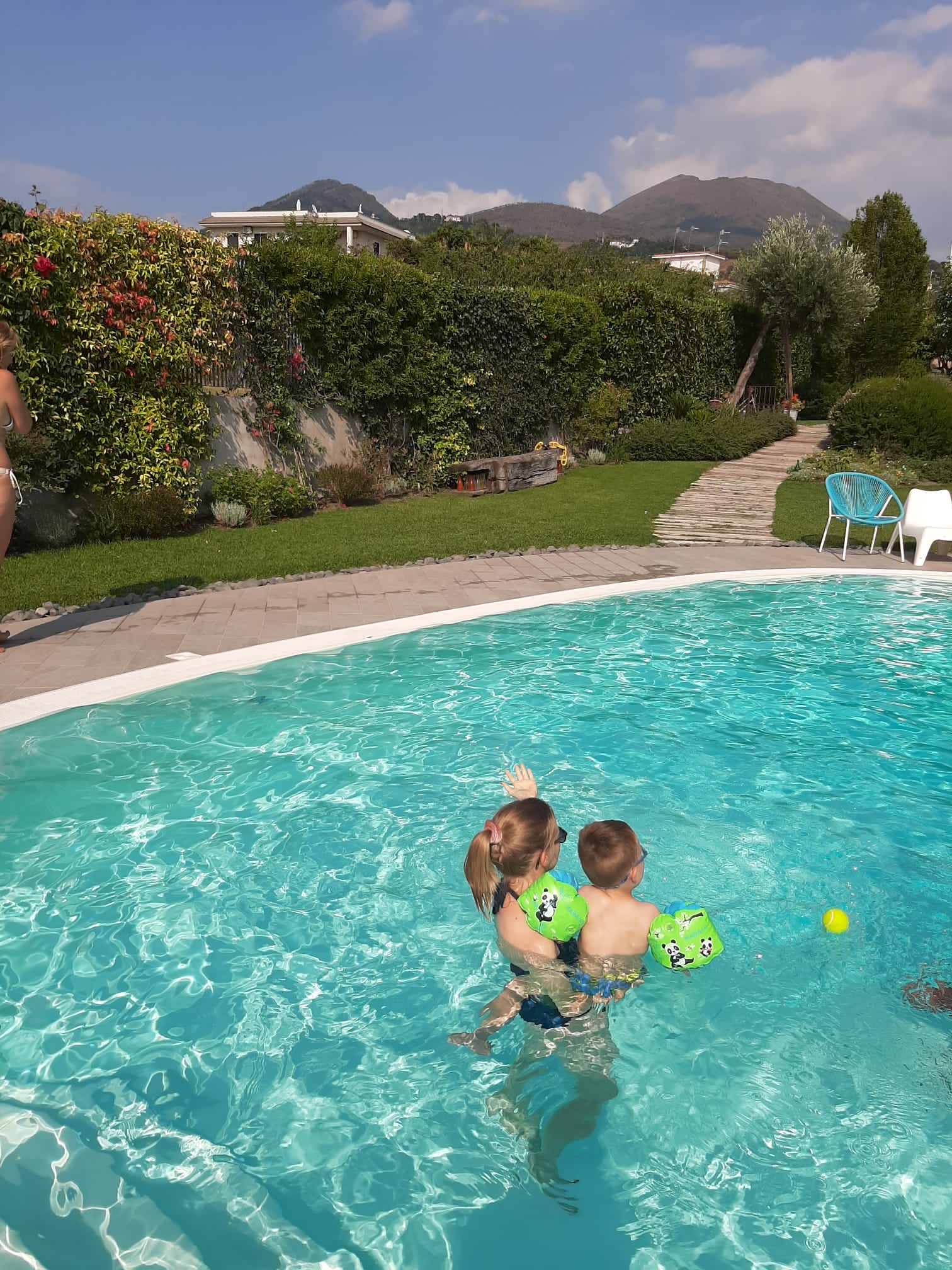 Travel blogger and son in pool in Ercolano