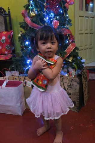 She's excited with every gift! Love her ballerina dress too.