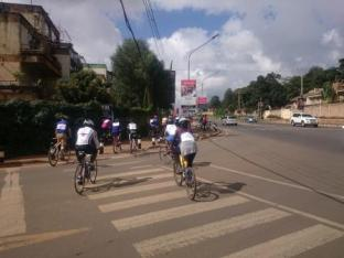 cyclists weaving in traffic somewhere in Nairobi