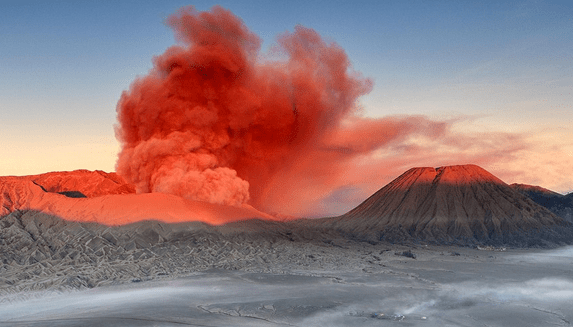 http://www.dailymail.co.uk/news/article-2320674/Mount-Bromo-spews-red-smoke.html