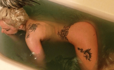 http://www.dailymail.co.uk/tvshowbiz/article-2582500/Lady-Gaga-shares-photo-naked-self-murky-bathtub-cleaning-dirty-SXSW-performance.html