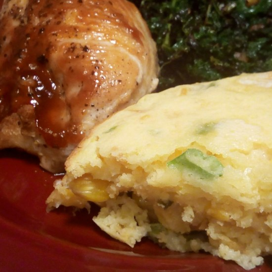 BBQ-Rubbed Crispy Chicken with Parmesan spoon bread and braised kale