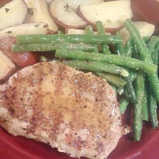 Grilled Pork Chop with Whole-Grain Dijon Sauce