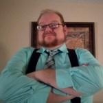 Matt wearing teal shirt with matching tie