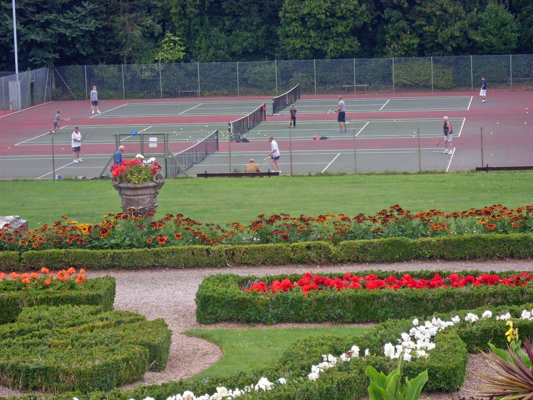 tennis court behind garden