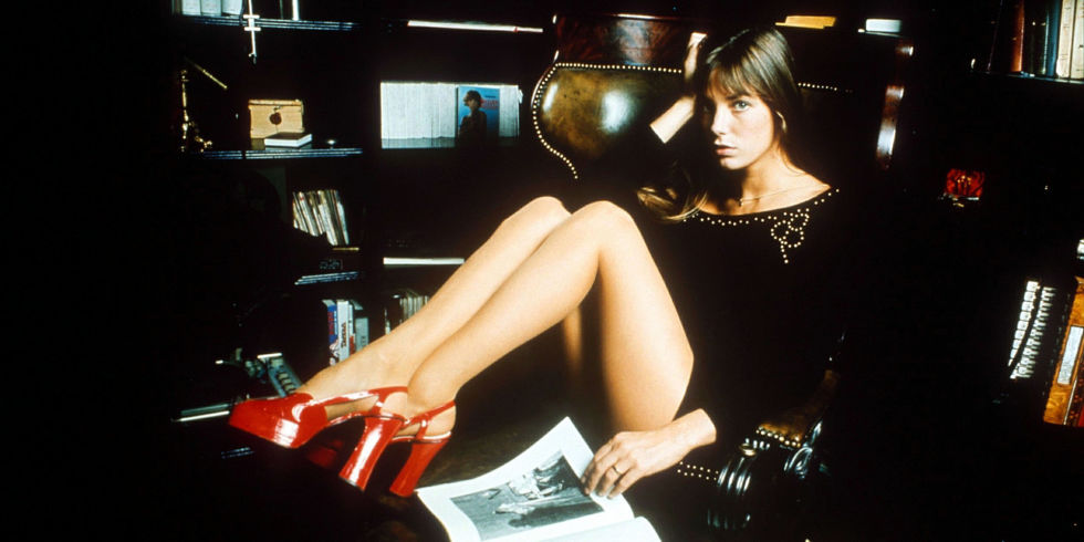 Jane Birkin puts a '70s spin on the LBD with a pair of sky-high scarlet platforms.