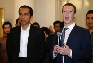 Facebook CEO Mark Zuckerberg, right, speaks during a joint press conference with Indonesian President-elect Joko Widodo, left, after their meeting in Jakarta