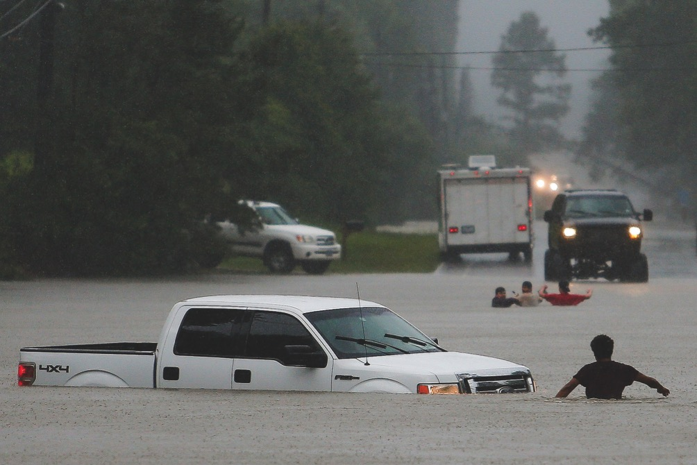 at least three people were still missing yesterday after torrential