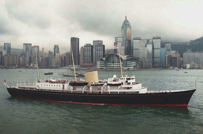1997 file photo showing the Royal Yacht Britannia passing the new Hong Kong Convention Center