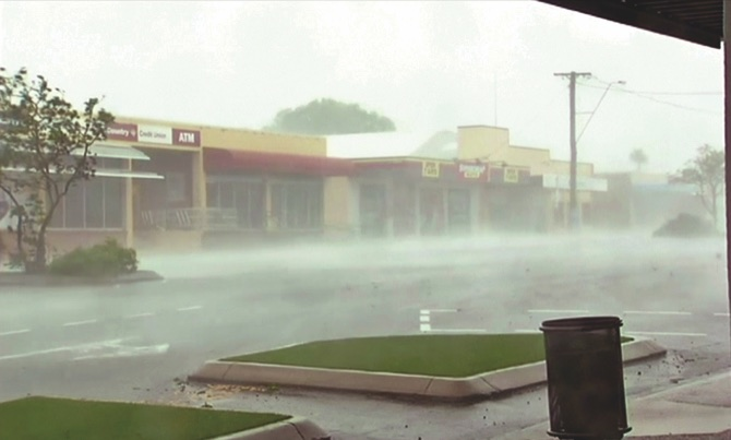 Cyclone downgraded, damaging winds and heavy rain remain