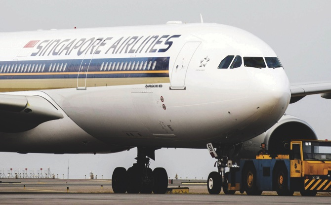 Singapore Airlines reports net loss in fourth quarter