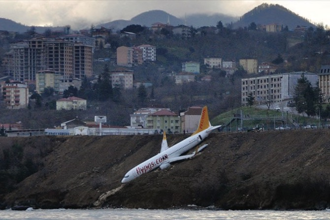 Turkish passenger plane skids off runway, gets stuck on cliff edge