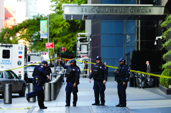 New York City Police Dept. officers arrive outside the Time Warner Center in New York