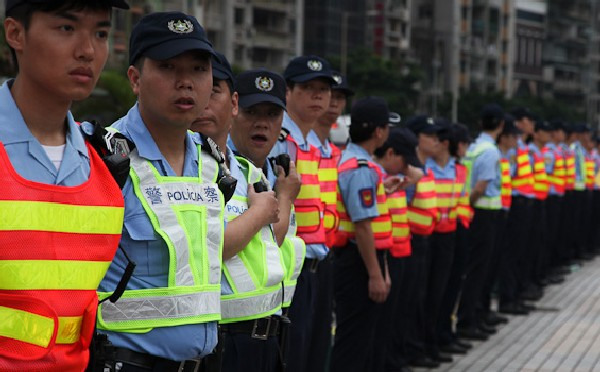 Sunburnt heads land 47 police cadets in Macau hospital