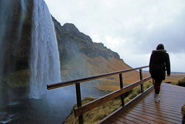 Walking across the bridge at Seljalandsfoss waterfall