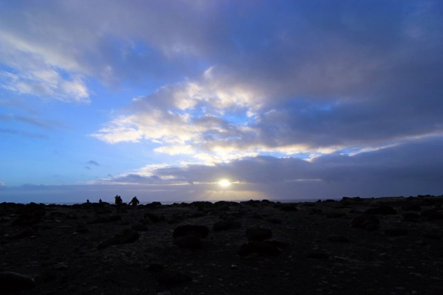 Boulders and black sand