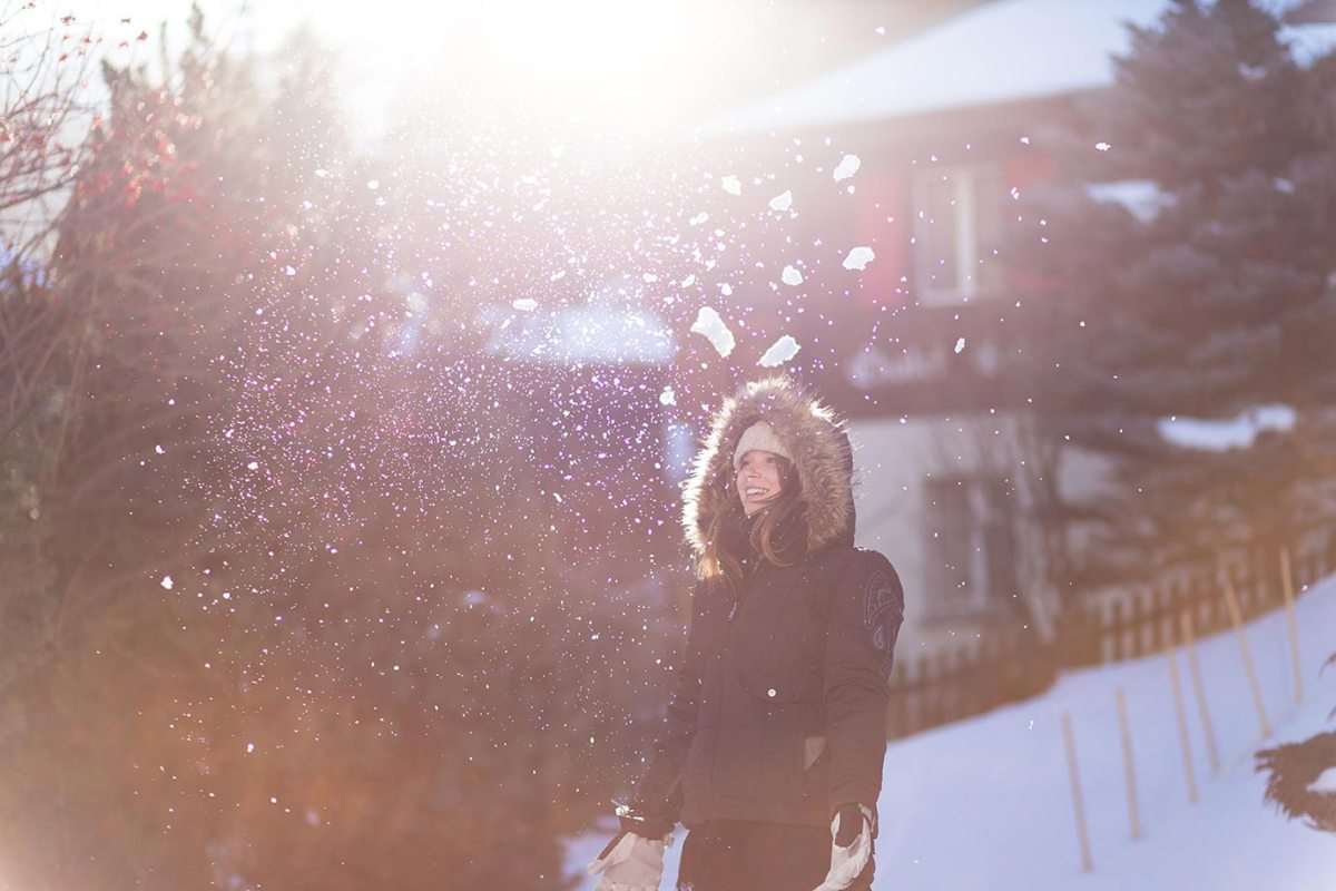 Chloe playing around in the snow in Switzerland