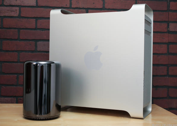 Apple's new Mac Pro (left) next to previous generation model.